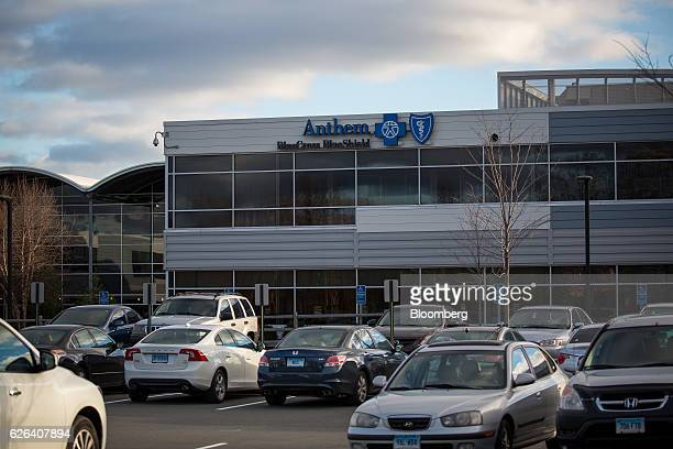 Vehicles sit in a parking lot in front of an Anthem Inc Blue Cross Blue Shield office building in Wallingford Connecticut US on Tuesday Nov 22 2016...