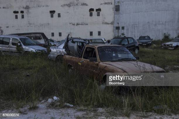 Vehicles sit in an empty lot near the Ilha Pura property604 empty luxury apartments used by more than 18000 athletes during the Olympic games in the...
