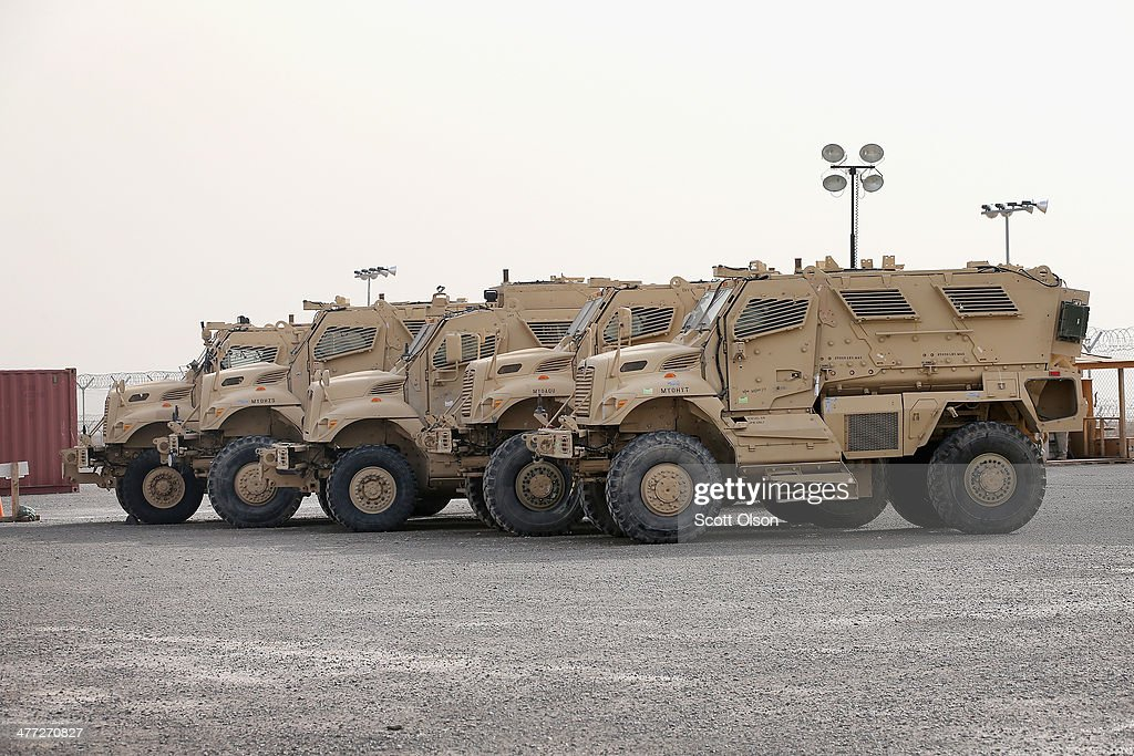 MRAP vehicles sit in Redistribution Property Accountability Team yard at Kandahar Airfield on March 8 2014 near Kandahar Afghanistan The RPAT...
