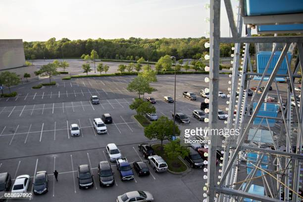 Vehicles sit in the parking lot of the Marley Station Mall next to Dream Wheel during the Dreamland Amusements carnival in Glen Burnie Maryland US on...