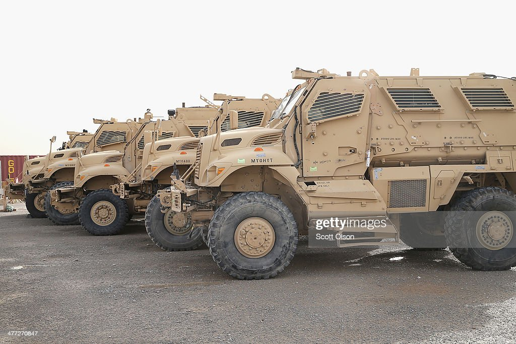 MRAP vehicles sit in the Redistribution Property Accountability Team yard at Kandahar Airfield on March 8 2014 near Kandahar Afghanistan The RPAT...