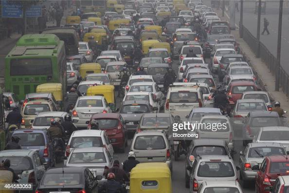 Vehicles sit in traffic on a road shrouded in haze in New Delhi India on Monday Jan 20 2014 India China and Brazil three of the largest developing...