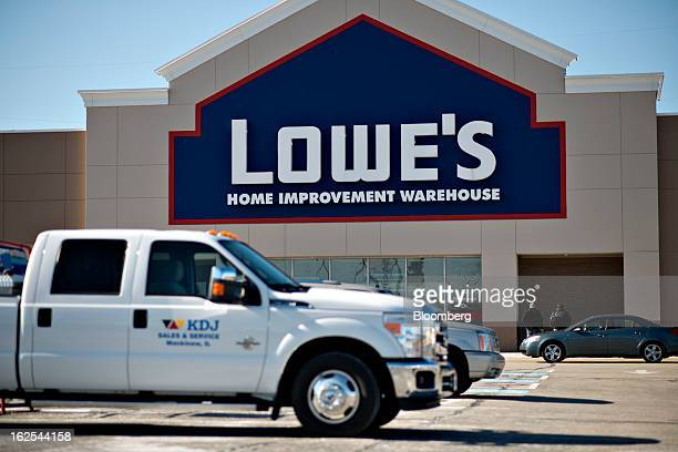 Vehicles sit outside a Lowe's store in East Peoria Illinois US on Wednesday Feb 20 2013 Lowe's Cos the secondlargest US homeimprovement retailer is...