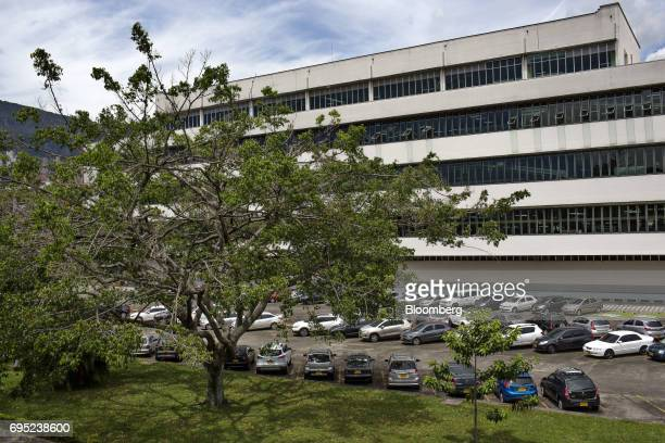 Vehicles sit parked outside of the Philip Morris International Coltabaco SAS production facility in Medellin Colombia on Friday June 2 2017 Philip...