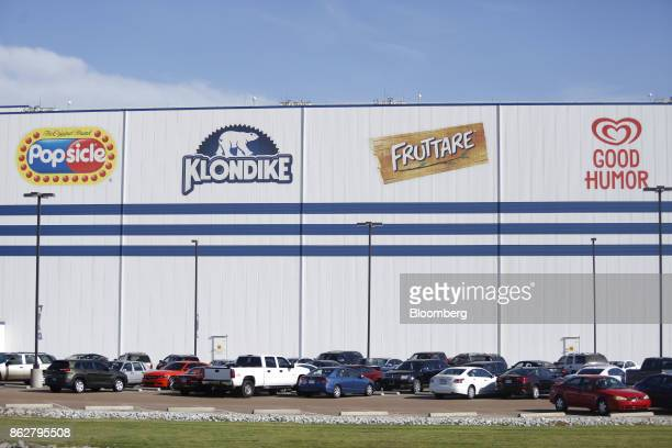 Vehicles sit parked outside of the Unilever Plc ice cream plant facility in Covington Tennessee US on Tuesday Oct 3 2017 Unilever is scheduled to...