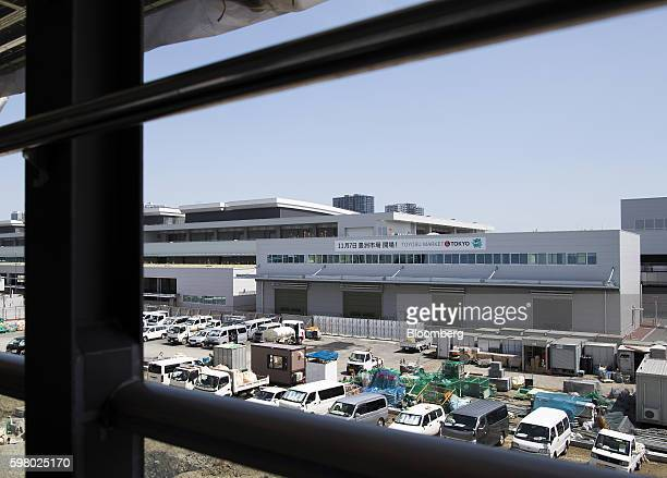 Vehicles sit parked outside the under construction Toyosu Market in Tokyo Japan on Wednesday Aug 31 2016 Yuriko Koike governor of Tokyo announced...