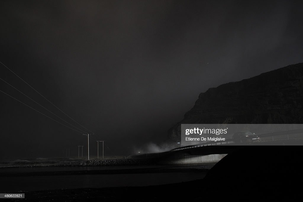 Vehicles speed through a dark fallout of ashes spewed by Eyjafjallajokull after the fallout completely blacked out visibility under the plume on May 13, 2010 near Reykjavik, Iceland.