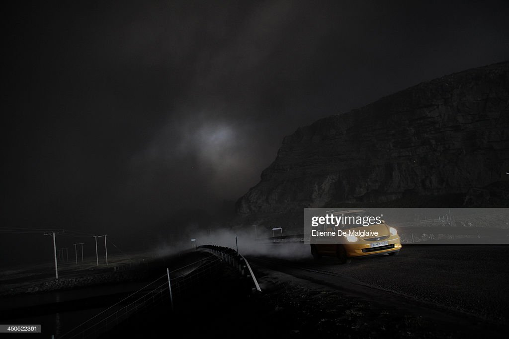 Vehicles speed trough a dark fallout of ashes spewed by Eyjafjallajokull after the fallout completely blacked out visibility under the plume on May 13, 2010 near Reykjavik, Iceland.