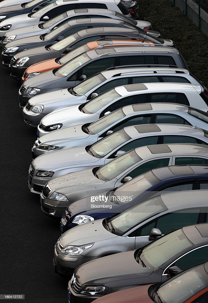 Vehicles stand in a parking lot in the Pudong area of Shanghai, China, on Wednesday, Jan. 30, 2013. China's economic growth accelerated for the first time in two years as government efforts to revive demand drove a rebound in industrial output, retail sales and the housing market. Photographer: Tomohiro Ohsumi/Bloomberg via Getty Images
