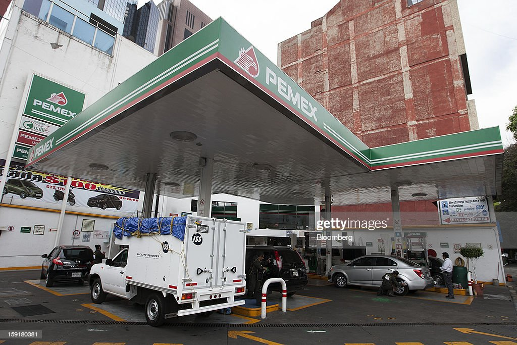 Vehicles stop to get gasoline at a Pemex station in Mexico City, Mexico, on Tuesday, Jan. 8, 2013. Mexico's government is speeding up the removal of subsidies on gasoline and increasing local unleaded gasoline prices by 11 centavos in January, according to the Finance Ministry. Photographer: Susana Gonzalez/Bloomberg via Getty Images