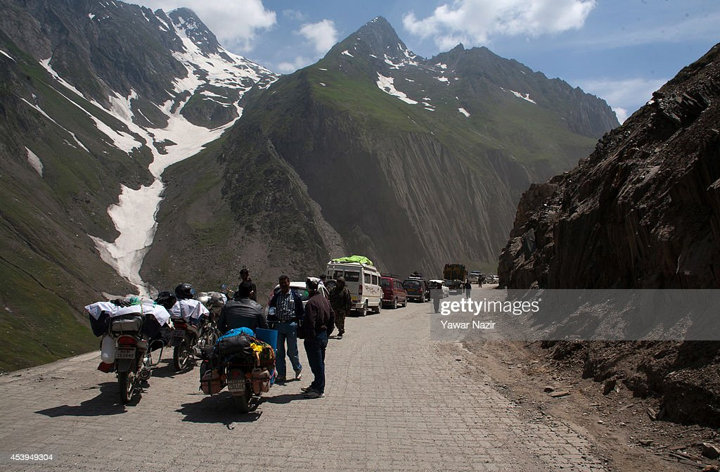 Vehicles stranded on a treacherous pass on August 22, 2014 in Zojila, about 108 km (67 miles) east of Zojila, has an impressive location, enclosed by Kashmir valley on one side and Drass valley on the other side and functions as a major link between Ladakh and Kashmir, is considered to be the World's most dangerous pass is located at 3529 meters. The average snow buildup on the rocky Zojila- which is part of the 443 km (275 miles) long Srinagar-Leh highway- normally stays in the level of 15 to 25 meters and is closed for half year. It opens up in late spring and witnesses violent breezes because of the conical shape. Travellers on the pass have to face and withstand snowstorms, fierce air currents, cold and highly dangerous circumstances.