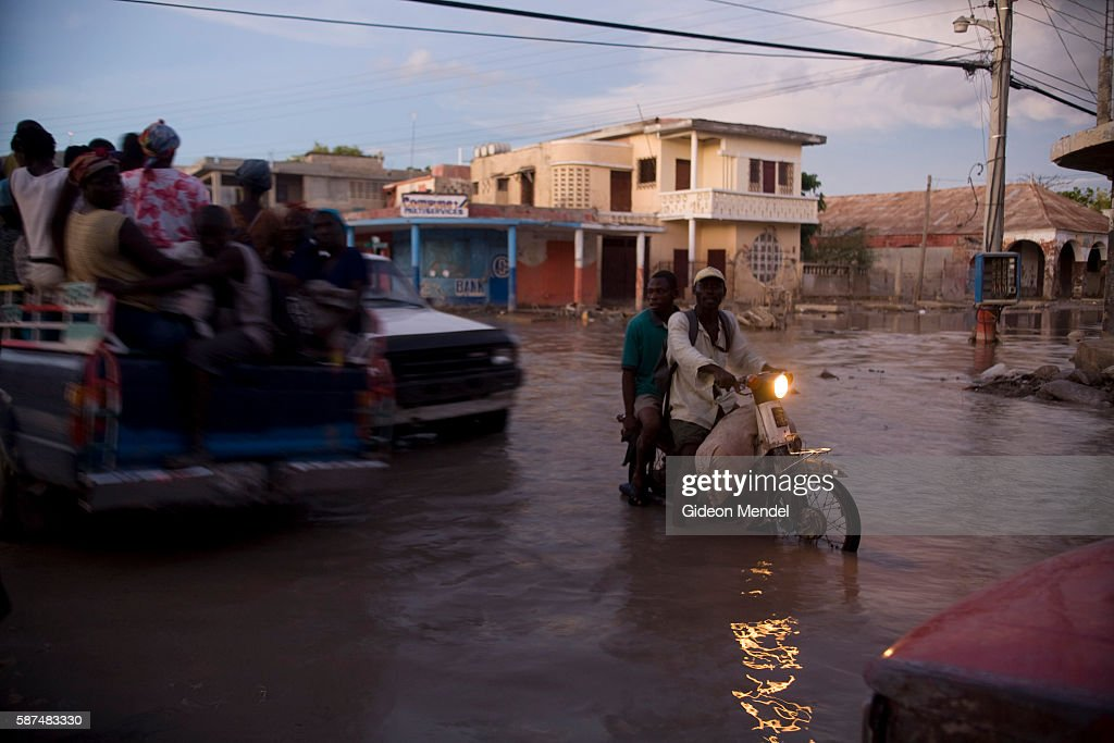 Vehicles struggle to cross a flooded intersection in the centre of the city of Gonaives two weeks after it was flooded during Hurricanes Ike and...