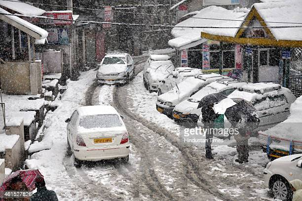 Vehicles stuck on road near Gandhi Chowk during snowfall on January 14 2015 in Dalhousie India Shimla and its surrounding resorts of Kufri Fagu and...