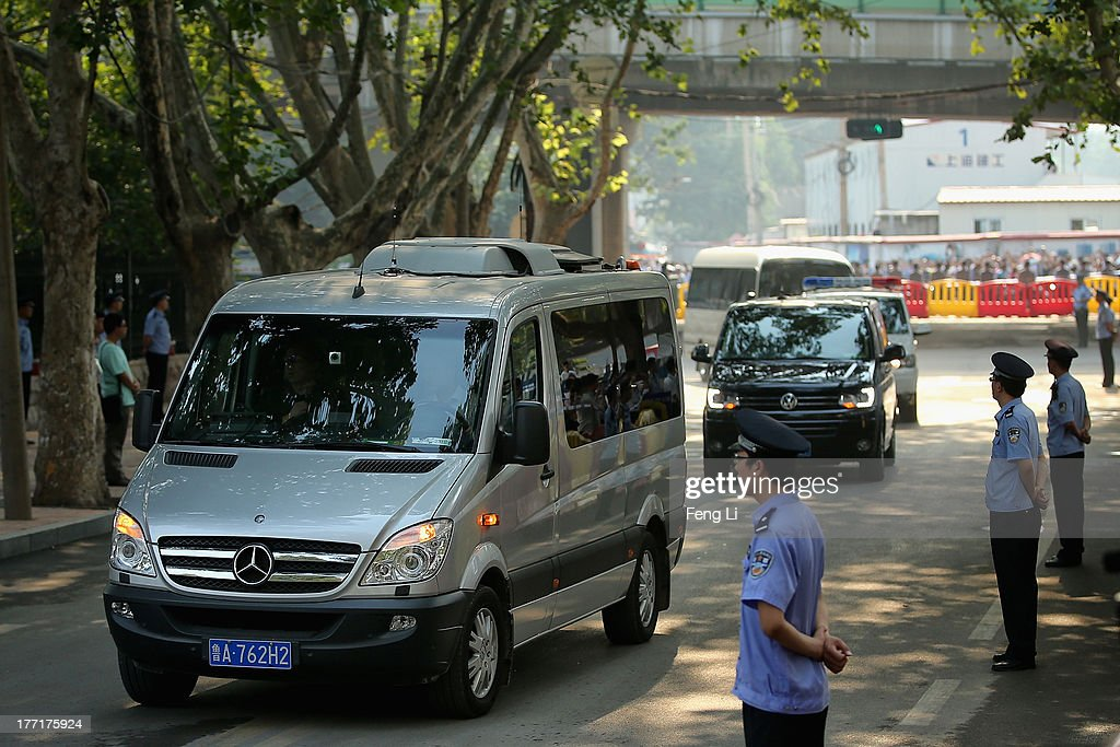 Vehicles that are part of a convoy believed to be transporting former Chinese politician Bo Xilai arrive at the Jinan Intermediate People's Court on August 22, 2013 in Jinan, China. Former Chinese politician Bo Xilai is standing trial on charges of bribery, corruption and abuse of power. Bo Xilai made global headlines last year when his wife Gu Kailai was charged and convicted of murdering British businessman Neil Heywood.