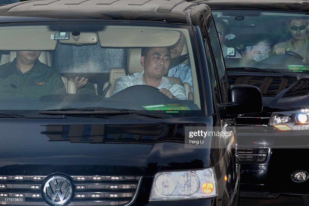 Vehicles transport former Chinese politician <a gi-track='captionPersonalityLinkClicked' href=/galleries/search?phrase=Bo+Xilai&family=editorial&specificpeople=225006 ng-click='$event.stopPropagation()'>Bo Xilai</a> (right car) and former police chief <a gi-track='captionPersonalityLinkClicked' href=/galleries/search?phrase=Wang+Lijun&family=editorial&specificpeople=4416065 ng-click='$event.stopPropagation()'>Wang Lijun</a> (left car) leaves as policemen blocked their faces with a board in the back of the vehicles after the third day of the trial of disgraced politician <a gi-track='captionPersonalityLinkClicked' href=/galleries/search?phrase=Bo+Xilai&family=editorial&specificpeople=225006 ng-click='$event.stopPropagation()'>Bo Xilai</a> at the Jinan Intermediate People's Court on August 24, 2013 in Jinan, China. Ousted Chinese politician <a gi-track='captionPersonalityLinkClicked' href=/galleries/search?phrase=Bo+Xilai&family=editorial&specificpeople=225006 ng-click='$event.stopPropagation()'>Bo Xilai</a> is standing trial on charges of bribery, corruption and abuse of power for a third day. <a gi-track='captionPersonalityLinkClicked' href=/galleries/search?phrase=Bo+Xilai&family=editorial&specificpeople=225006 ng-click='$event.stopPropagation()'>Bo Xilai</a> made global headlines last year when his wife Gu Kailai was charged and convicted of murdering British businessman Neil Heywood.