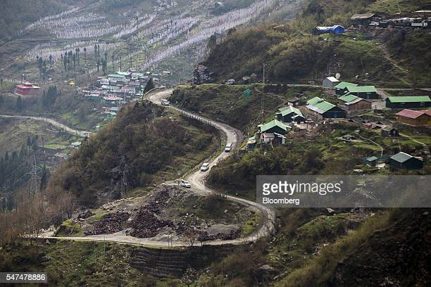 Vehicles travel along a mountain road near the Nathula Pass an open trading post in the Himalayas between India and China in Sikkim India on...