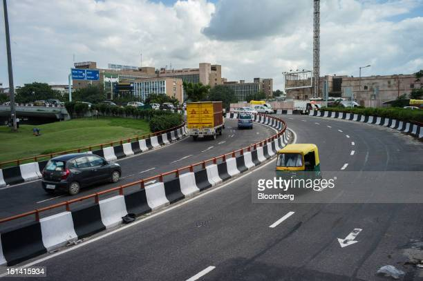 Vehicles travel along a road in New Delhi India on Wednesday Sept 5 2012 India's failure to meet goals to expand transportation networks is...