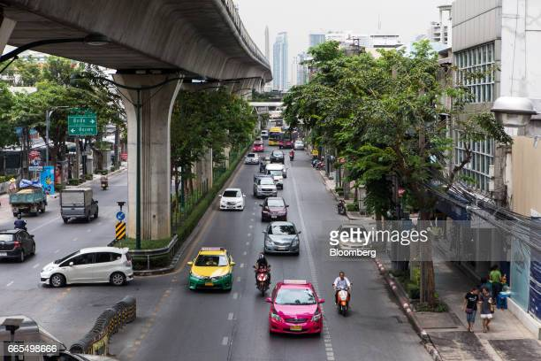 Vehicles travel beneath a SkyTrain track operated by Bangkok Mass Transit System Pcl a unit of BTS Group Holdings Pcl in the Phaya Thai District of...