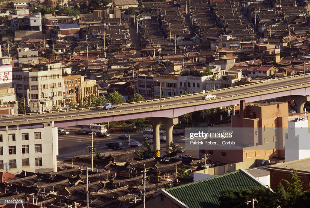 Vehicles travel down a viaduct in Seoul.