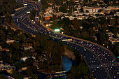 Vehicles travel during rush hour on the US 101 freeway in this aerial photograph taken over the Sherman Oaks neighborhood of Los Angeles California...