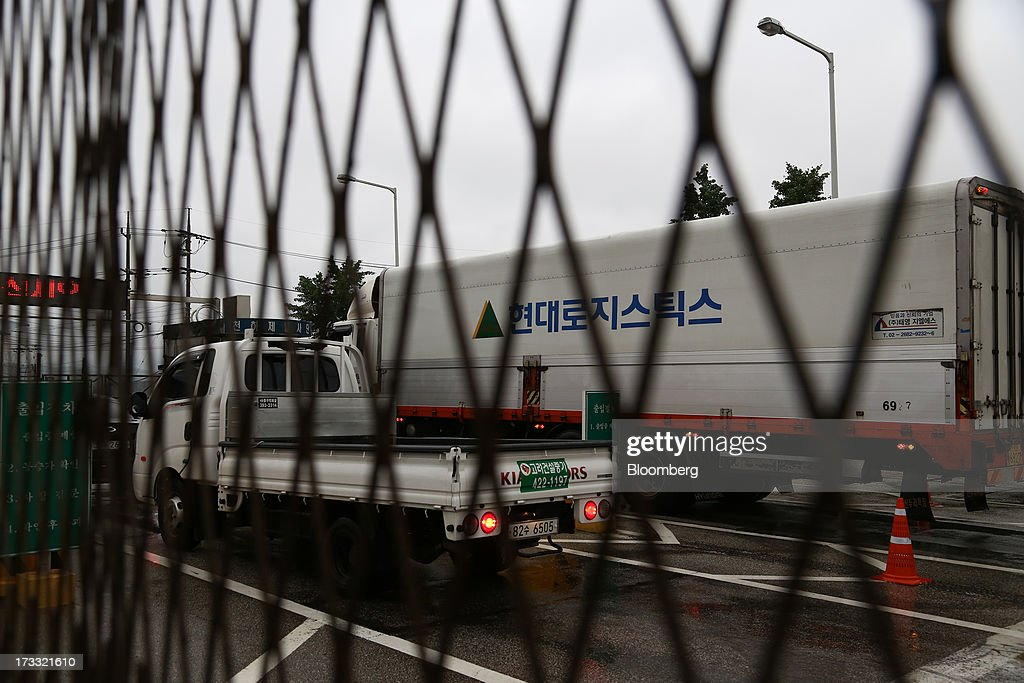 Vehicles traveling toward Gaeseong Industrial Complex wait in line at a military check point on the Unification Bridge, linked to North Korea, near the demilitarized zone (DMZ) in Paju, South Korea, on Friday, July 12, 2013. North Korea notified South Korea today that it has deferred two separate sets of talks on the tours and the family reunions it proposed yesterday, and said it wants to focus on the ongoing dialog to reopen the joint Gaeseong industrial zone, the Souths Unification Ministry said in an e-mailed statement. The two sides yesterday decided to hold talks in Gaeseong on July 15, which will be their third round in one week, on normalizing operations in Gaeseong after the North unilaterally recalled its workers in April. Photographer: SeongJoon Cho/Bloomberg via Getty Images