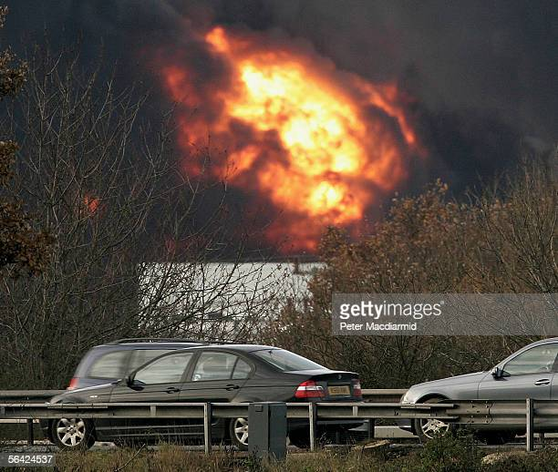 Vehicles use the M1 motorway as Buncefield oil depot continues to burn for a third day on December 13 2005 in Hemel Hempstead England Fire fighters...