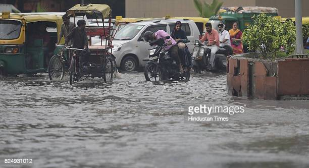 Vehicles wade through logged rain water during a heavy rainfall at Delhi Gate on July 31 2017 in New Delhi India Delhiites woke up to a drenched...