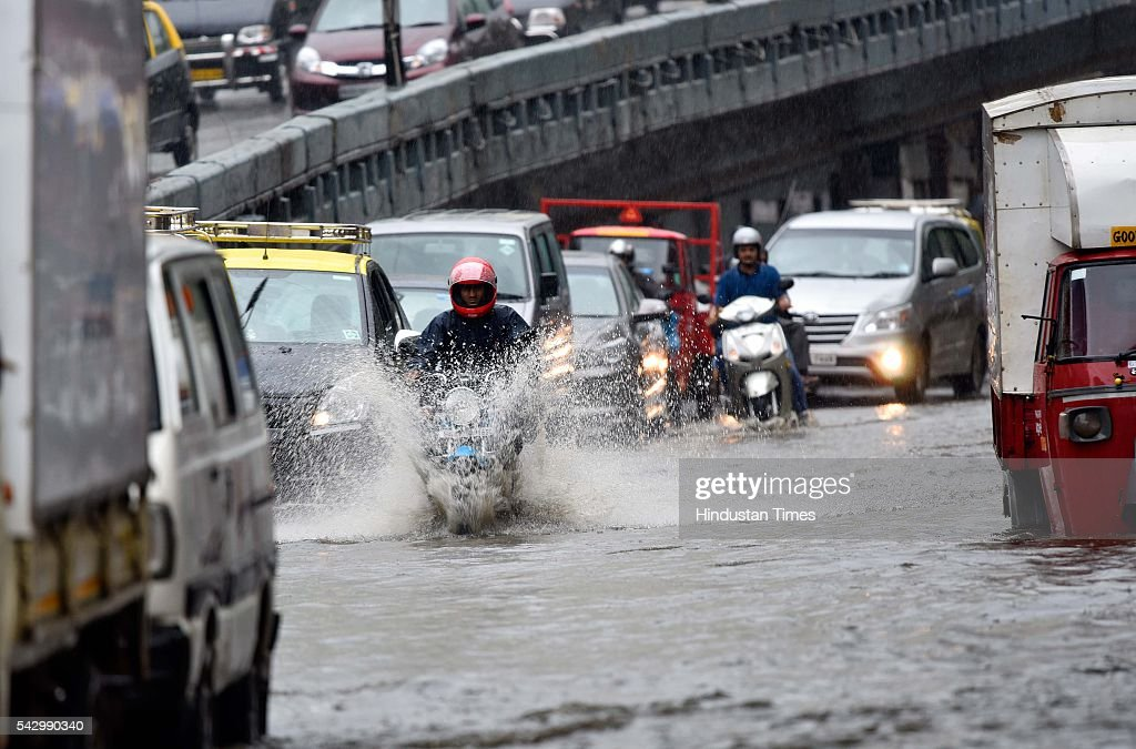 Vehicles wade through water logged area at Parel after heavy rain, on June 24, 2016 in Mumbai, India. Rains continued to lash Mumbai for the third consecutive day today, slightly disrupting suburban train services, even as the Met department predicted heavy showers. India Meteorological Departments Regional Meteorological Centre in Mumbai predicted intermittent rain with heavy to very heavy rainfall at a few place in the city and its suburbs for the next 24 to 48 hours.