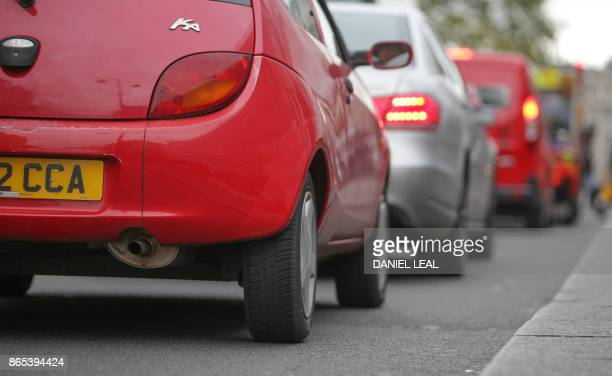Vehicles wait in a traffic in central London England on October 23 2017 Drivers of the most polluting vehicles will face an extra daily charge for...