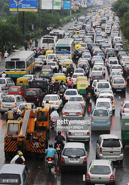 Vehicles wait in a traffic jam in New Delhi on September 10 2009 Over 13 mm of rains overnight with drizzle continuing caused traffic chaos on water...