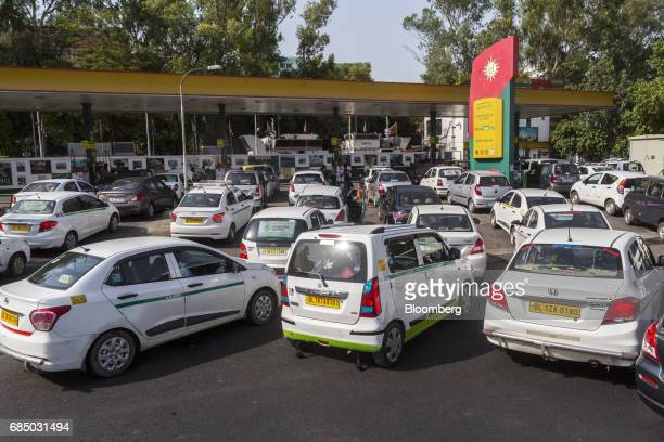Vehicles wait in line to be refueled with compressed natural gas at an Indraprastha Gas Ltd gas station in New Delhi India on Wednesday May 17 2017...