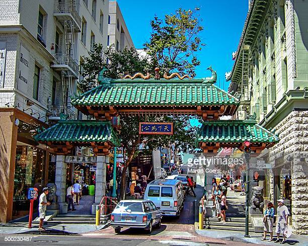Vehicular and foot traffic in Chinatown San Francisco California