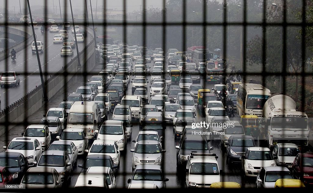Vehicular Traffic lined up on Outer Ring road near Rao Tula Ram Marg due to early morning rain spell on February 4, 2013 in New Delhi, India. MeT Office has predicted that the capital is likely to experience hailstorms and rains in some parts.