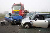 Vehicules wreckages are pictured on the A19 highway near ZonnebekeBeselare after a multiple collision accident caused by dense fog on December 3 2013...