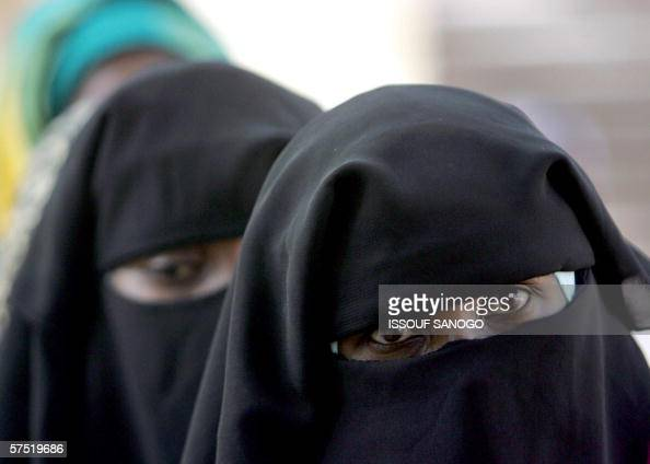 Veiled Chadian women queue in front of a polling station in N'Djamena 03 May 2006 prior to voting for the first round of Presidential elections...