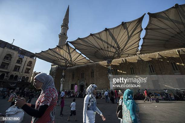 Veiled Egyptian women walk near alHussein mosque in Cairo on July 14 2016 Many believed that Mohamed Morsi's ouster amid mass protests and...