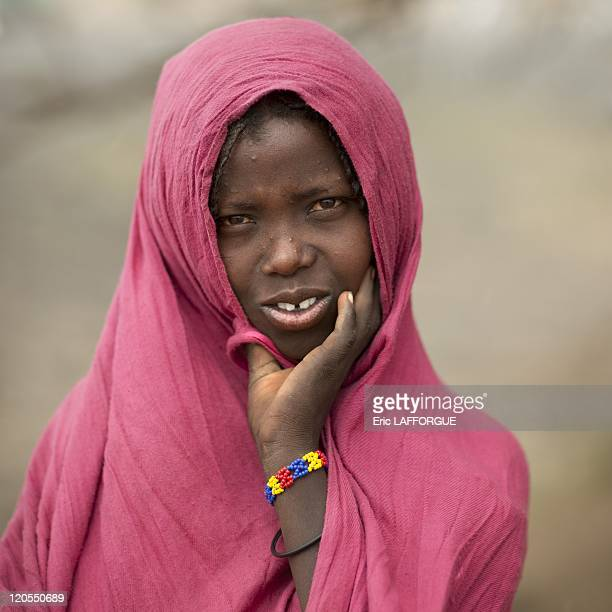 Veiled Karrayyu girl lake Metahara area in Ethiopia on July 11 2010 The Karrayyu are a pastoralist tribe from Ethiopia living in the Awash Valley...