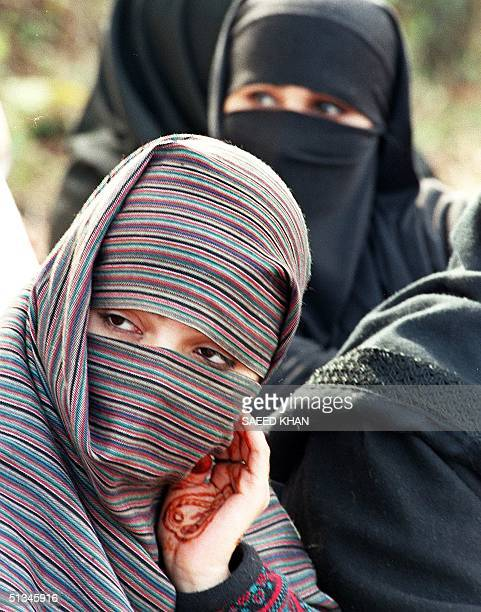 Veiled Kashmiri women stage a sitin protest in front of the Indian High Commission building in Islamabad 26 January Hundreds of Kashmiri men and...