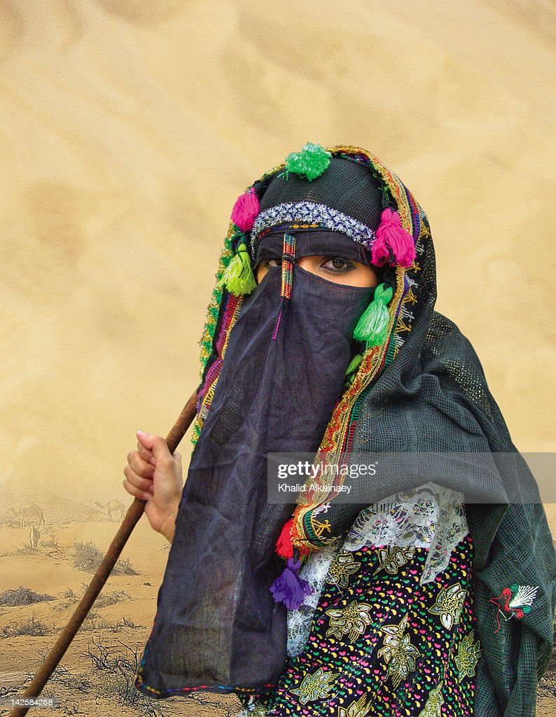 Veiled muslim Arab girl in traditional costumes : Stock Photo