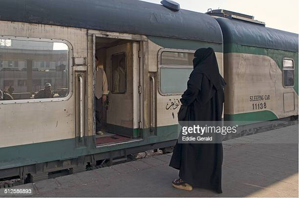 A veiled Muslim woman at A train station in Cairo Egypt