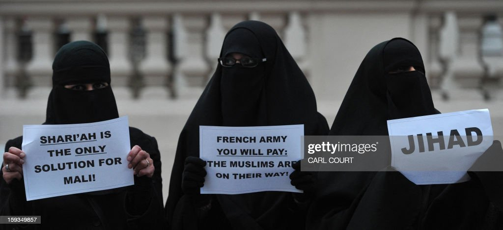 Veiled Muslim women hold up signs as they join a protest in response to French military action in Mali outside the French embassy in central London on January 12, 2013. Around 50 Muslim protesters shouted slogans and waved signs as they demonstrated outside the French embassy against French intervention in Mali. France sent troops on January 11 to help Malian forces hold back a rebel advance towards the capital Bamako, and on January 12 Paris announced that a French military pilot had been killed.