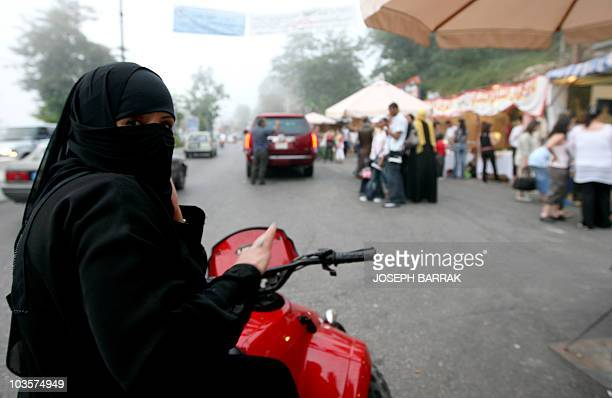 A veiled Saudi women rides a motorbike in the tourist town of Aley east of Beirut on July 23 2008 The Lebanese tourism ministry predicts between 13...