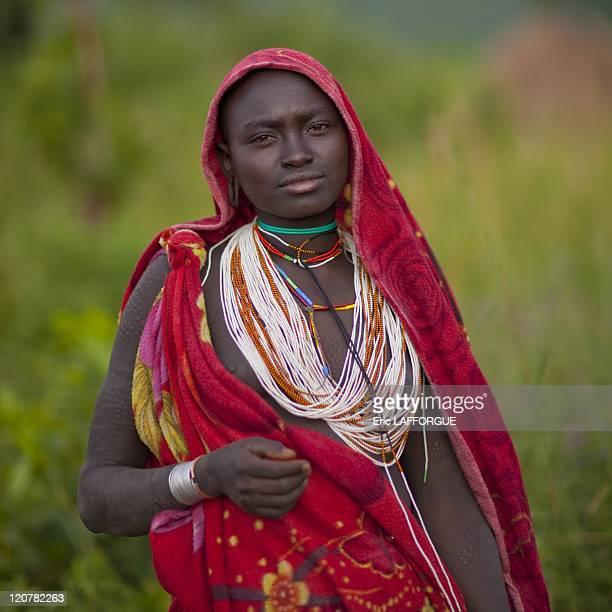 Veiled Suri girl in Turgit village Omo valley Ethiopia on July 05 2010 Surma or Suri are sedentary pastoral people living in south west of Ethiopia...