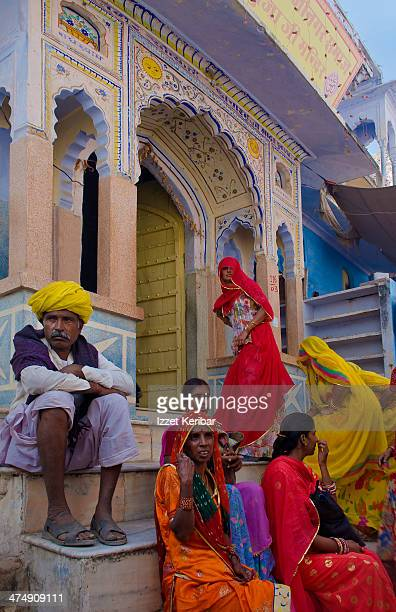 Veiled visitors at a temple's entrance in Pushkar