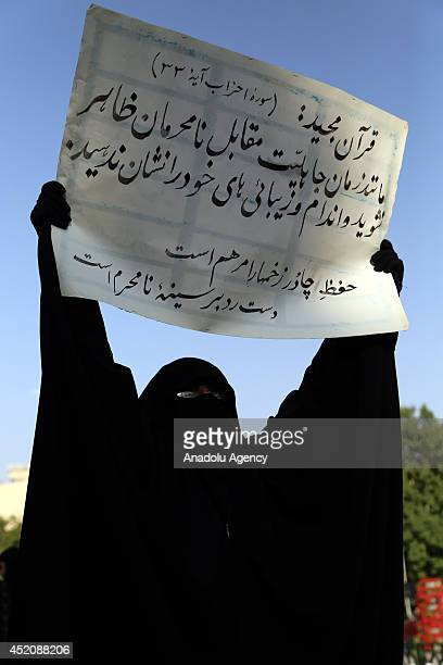 A veiled woman demands to be enforced of hijab law on the constitution on Hijab and Chastity National Day in Mashhad Iran on 12 July 2014
