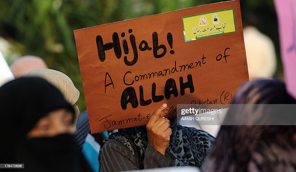 Veiled women activists of the Pakistani fundamentalist Islamic political party JamaatiIslami hold placards during a rally in Islamabad on September 4...