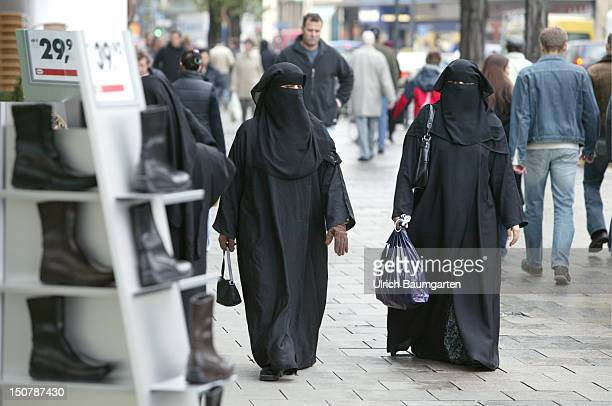 Veiled women on a shopping street in Munich