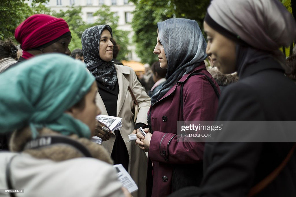 Veiled women take part in a demonstration on May 18, 2013 in Paris to ask for veiled parents to ask for the right of veiled parents to take their children to school. France has banned the wearing of niqabs - veils which cover the full face - in public.