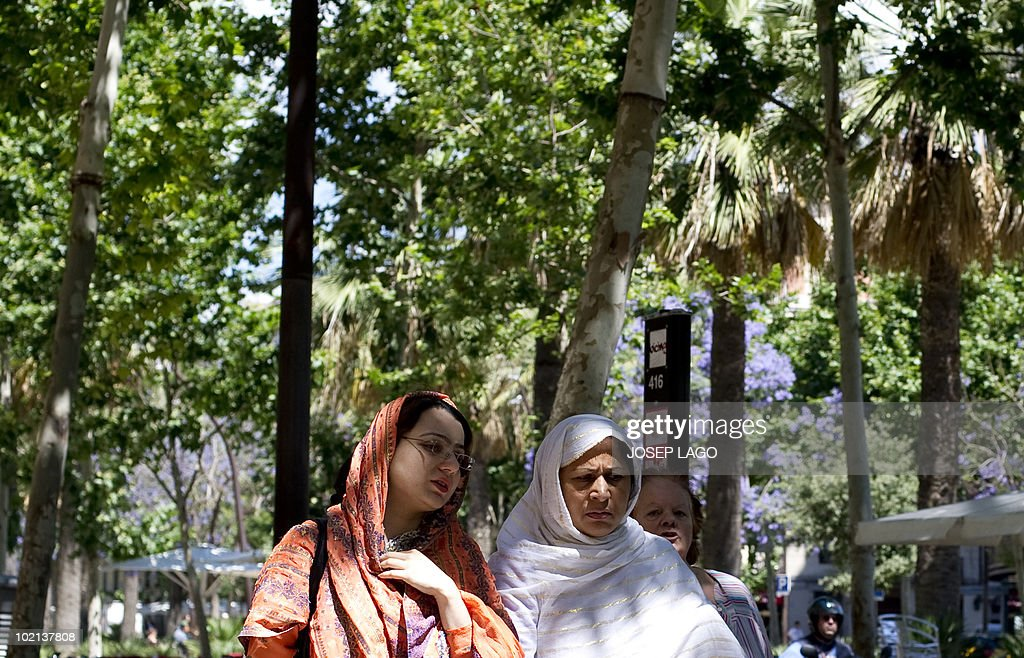 Veiled women walk in Barcelona on June 16, 2010. Spain's government plans to ban the use of the Islamic burqa in public places under a proposed new law on religious freedom, the justice minister said on June 15, 2010. His remarks came a day after the mayor of Barcelona, Jordi Hereu, announced it would be the first large city in Spain to ban the use of the full-face Islamic veil in public buildings. Immigration from Muslim countries has soared in Spain since the 1990s, with Catalonia in particular being home to a large community of Pakistani origin.