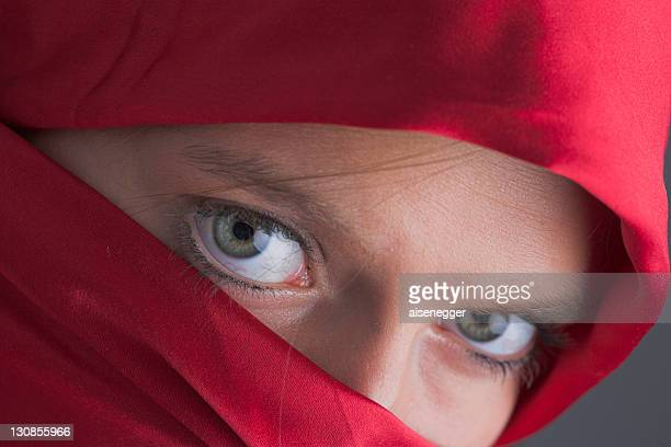 Veiled, young woman with sharp eyes